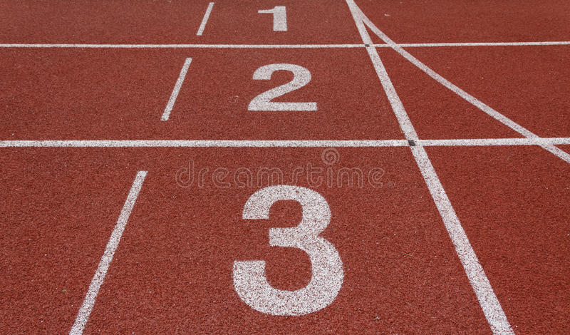 Running track. Perspective of start and finish position on running track royalty free stock photo