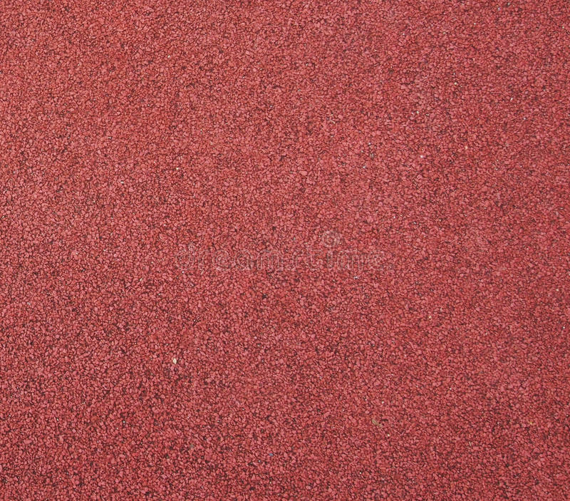 Running track. Red running track texture detail royalty free stock photo