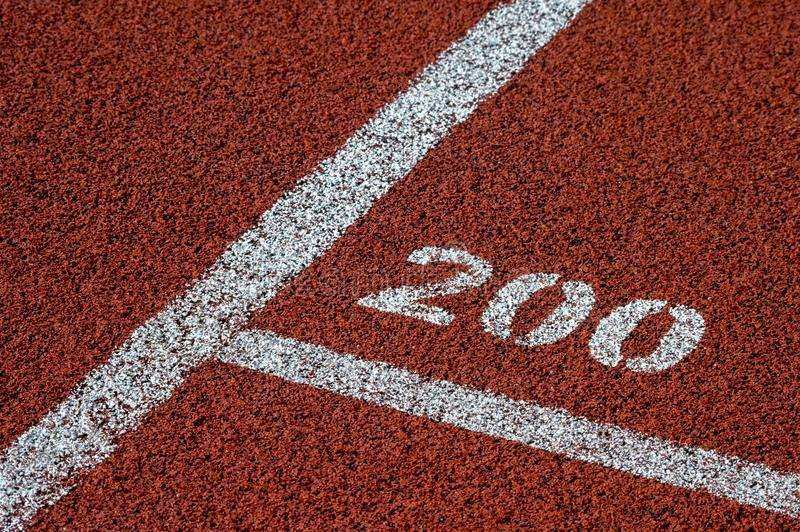Running track rubber standard red color and white line and number 200 stock photos
