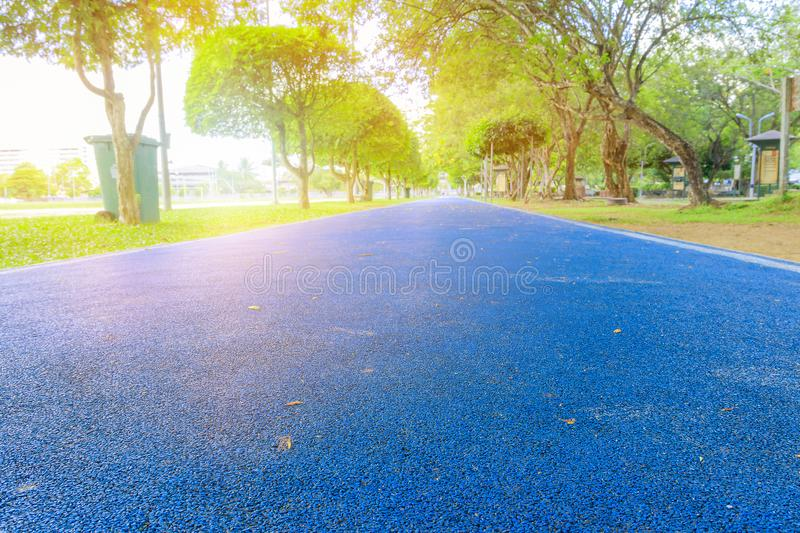 Running track in runner rubber cover blue public park. for jogging exercise health lose weight concept copy space add. Text, select focus with shallow depth of royalty free stock photo
