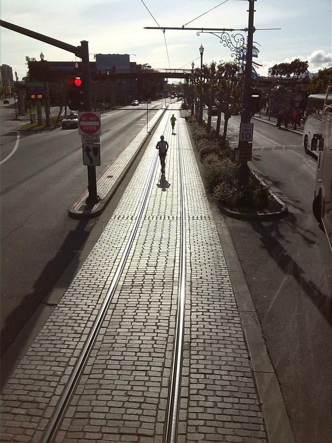 Running on tracks stock photos