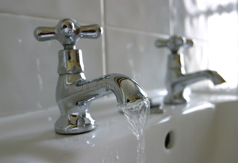 Running Water Bathroom Taps stock photos