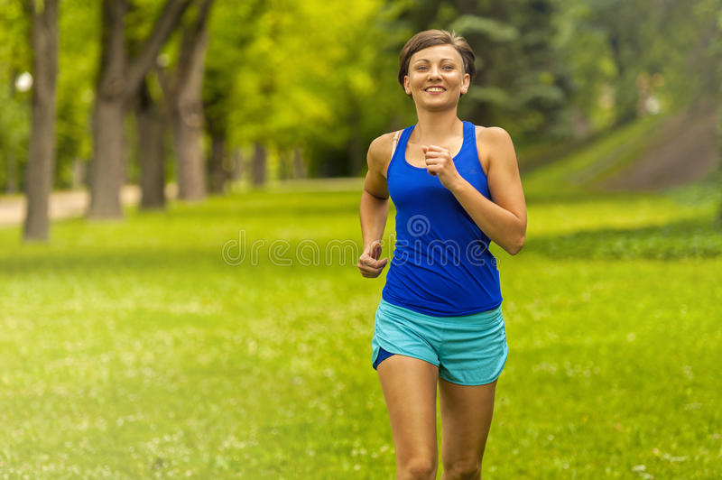 Running woman. Female Runner Jogging during Outdoor Workout . royalty free stock photos