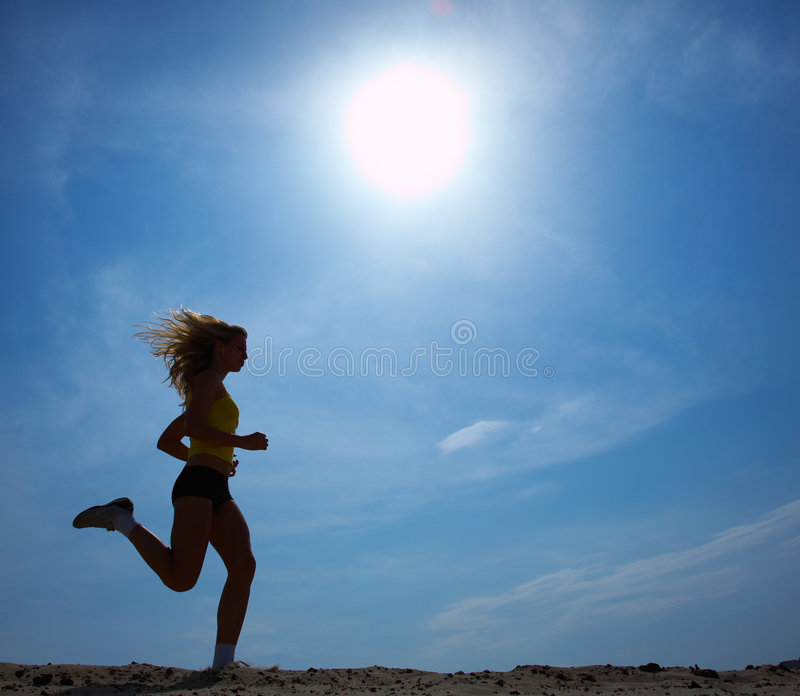 Running woman with sky royalty free stock photos