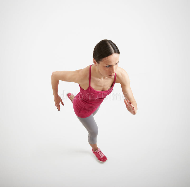 Running woman in sportswear royalty free stock photos