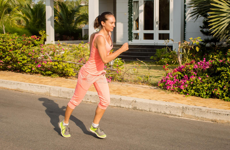 Running woman in summer training. Sport fitness model in sporty royalty free stock photo