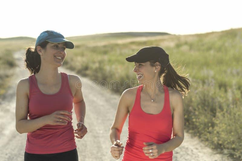Running women talking royalty free stock photos