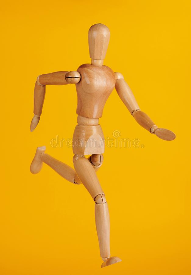 Running wooden doll royalty free stock image