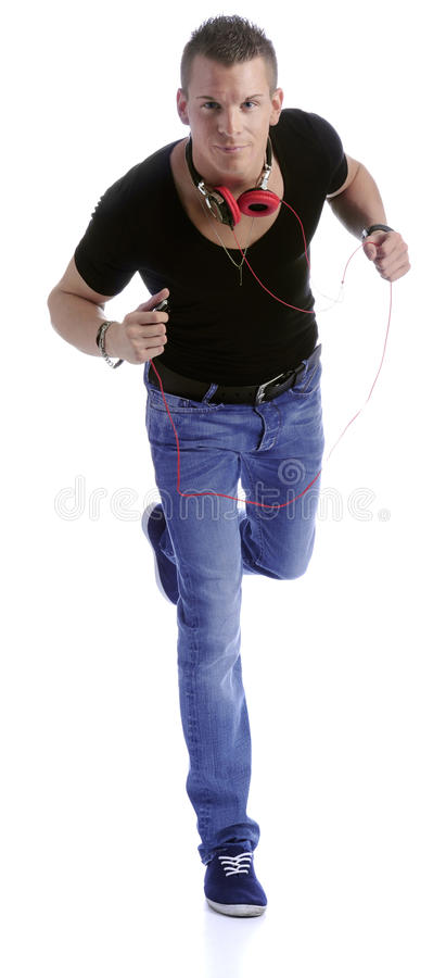 Download Running Young Man With Earphone Stock Photo - Image of blue, smile: 20417660