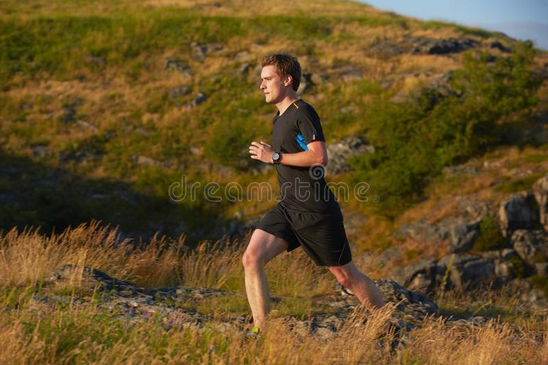 Running. Young man is running in nature - selective focus stock photo