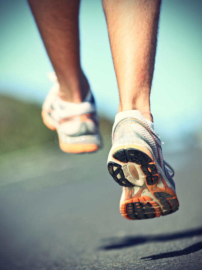 Download Runnning shoes on runner stock photo. Image of athletes - 20518148