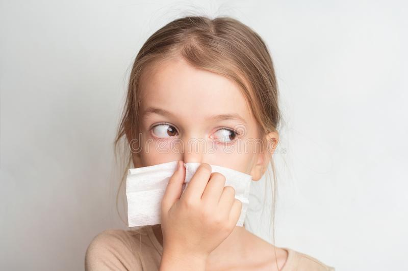 Runny nose in children. A child blows his nose in a handkerchief. Runny nose in children. A child blows his nose in a handkerchief stock photo