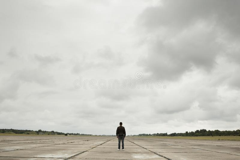 Runway. Mystery man in the midle of the old runway stock image