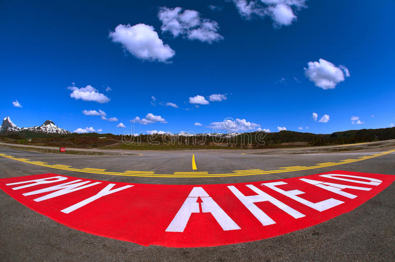 RUNWAY AHEAD. FORDE BRINGELAND, NORWAY - JUNE 2012 The warning sign painted on the taxiway warning that entry of the active runway is about to happen. Do not stock photo