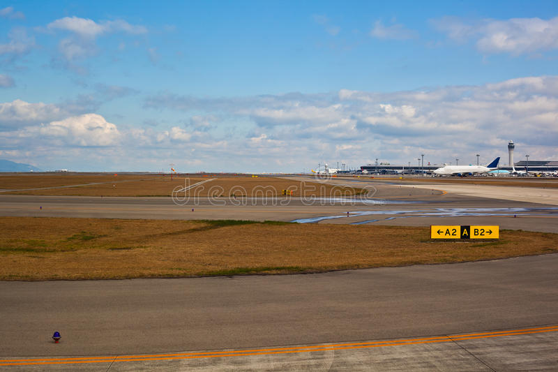 Runway at the airport. This is a wide runway at the airport stock photo