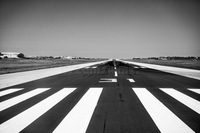 Runway 31 Malta. Runway 31, to be found on the Island of Malta. Malta International Airport (Maltese: Ajruport Internazzjonali ta 'Malta), is the only airport in royalty free stock image