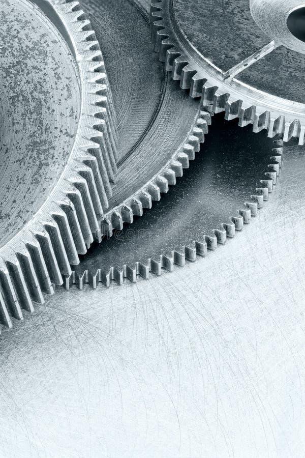 Ruote dentate del macchinario di grey d'acciaio sulla macro industriale del fondo immagine stock