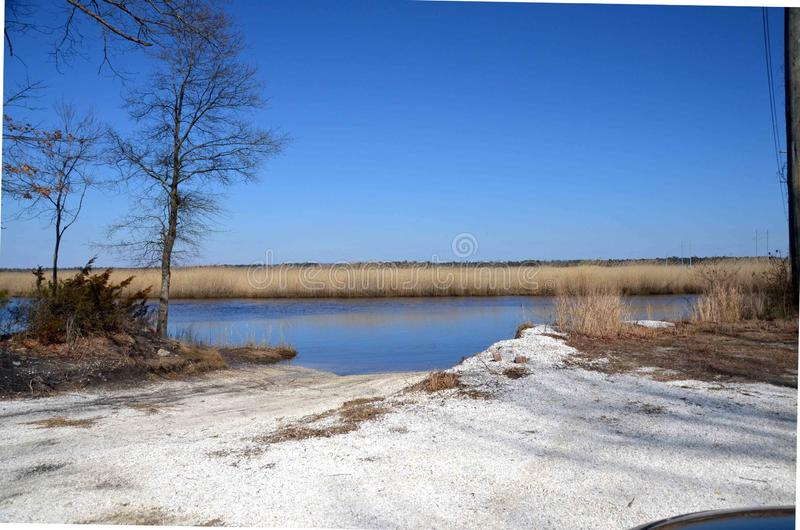 Clam Shell Parking Lot. A rural boat launch in southern New Jersey made white by gravel of crushed clam shells often used for that purpose locally royalty free stock photo