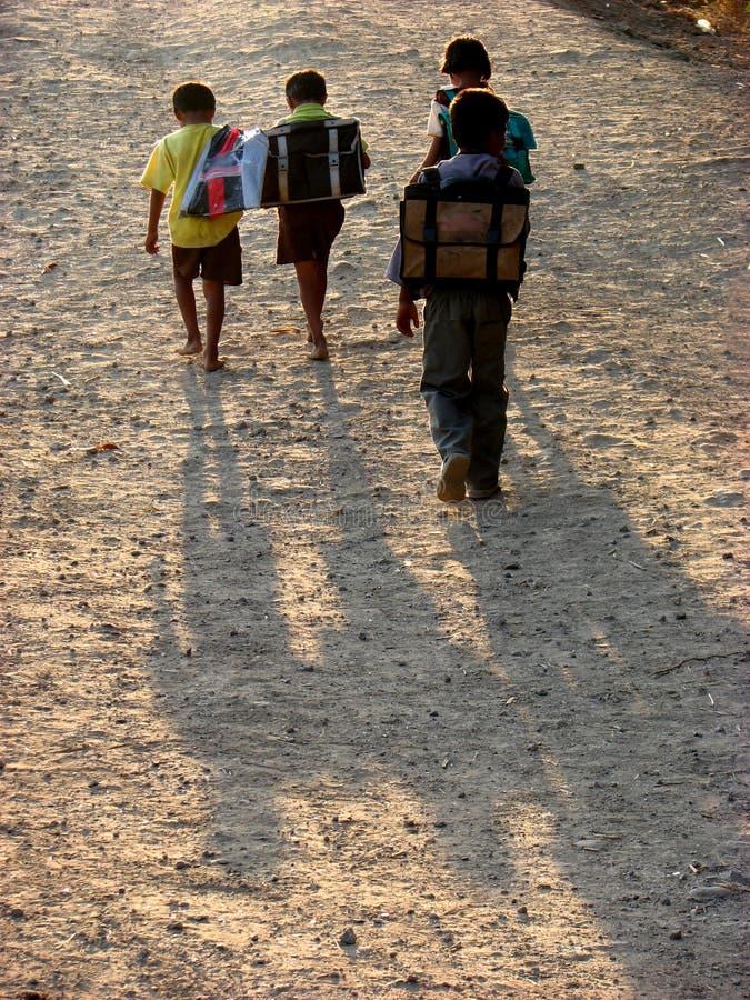 Rural Boys. Rural Indian school children going home stock photos