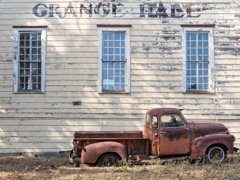 Rural California Grange Hall. Old Ford truck is abandoned at an historic Grange Hall stock photos