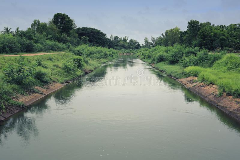 Rural canal on a weather is airy. Rural canal on a weather is airy for use water in farming,Full water way stock photos