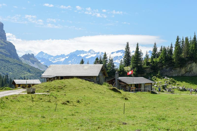 Rural chalets at Engstlenalp over Engelberg on Switzerland. Rural chalets at Engstlenalp over Engelberg on the Swiss alps stock image