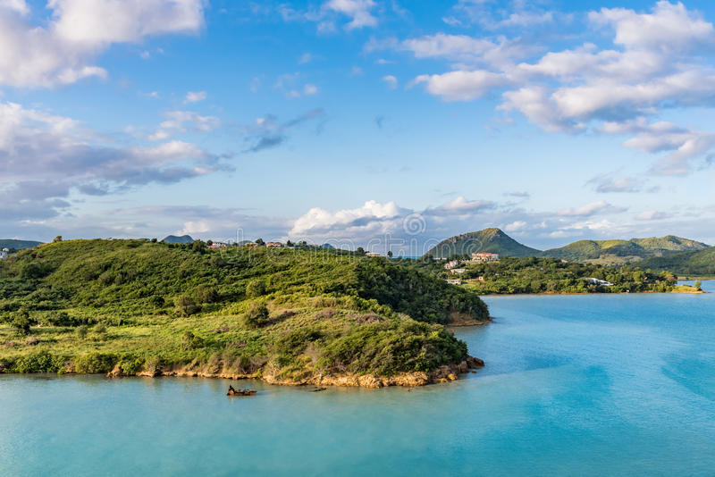 Rural corner of the island of Antigua at sunrise. View from the ocean of a rural corner of the island of Antigua at sunrise royalty free stock photos
