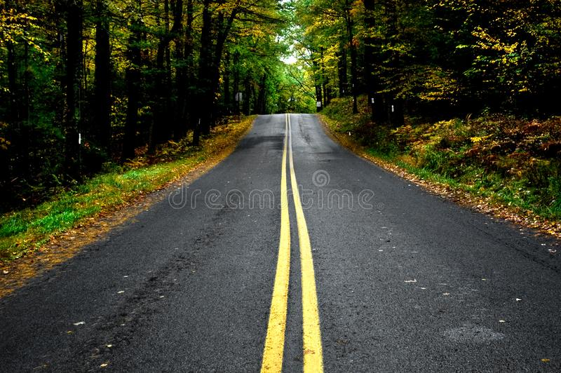 Rural country Pennsylvania roads in autumn. A drive through rural back country Pennsylvania roads with fall foliage in autumn stock photography