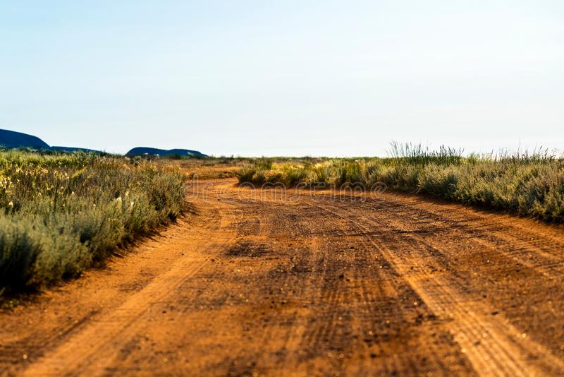 Rural dirt road landscape in steppe or desert royalty free stock images