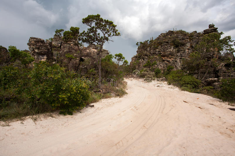 Rural dirt road. With sand and sandstone rocks stock photos