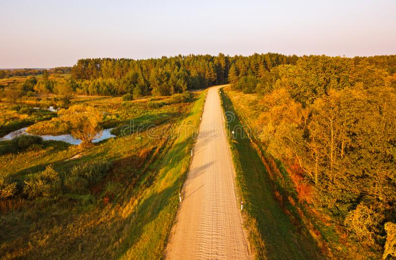 Rural dirt road view from above. Aerial view on countryside road royalty free stock image