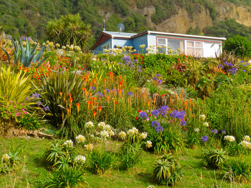 Rural dream house in lush flowering natural garden stock photography