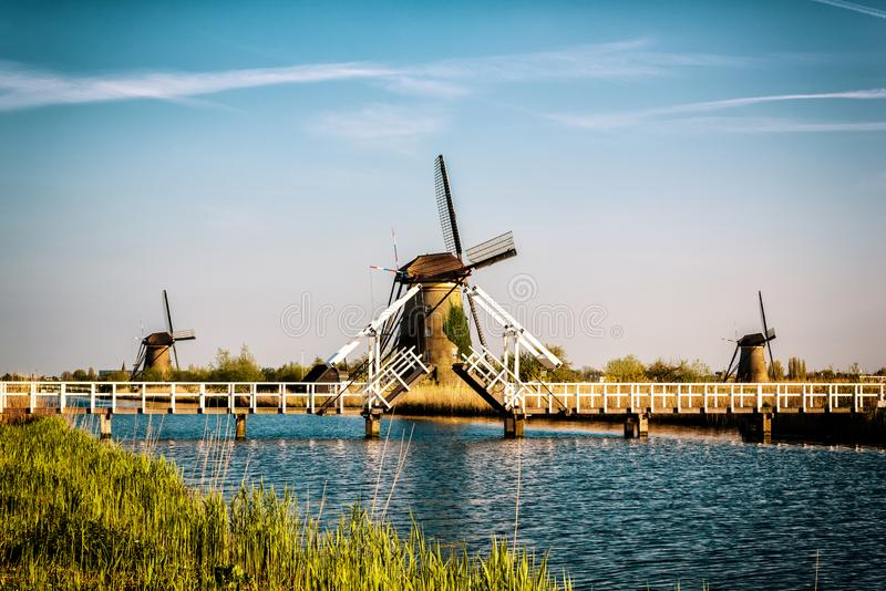 Dutch landscape with windmills, blue sky and water, Kinderdijk, Netherlands royalty free stock photo