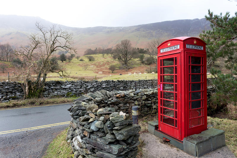 Rural English phone box. An iconic English telephone box in the Lake District National Park. The phone boxes were once important for communication but fell into royalty free stock photography