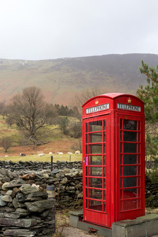 Rural English phone box. An iconic English telephone box in the Lake District National Park. The phone boxes were once important for communication but fell into royalty free stock image