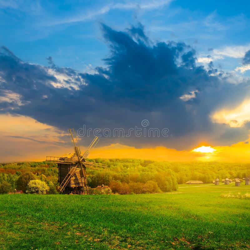 Free Rural Ethnic Landscape, Green Fields With Wooden Windmill At The  Sunset Royalty Free Stock Image - 184002676