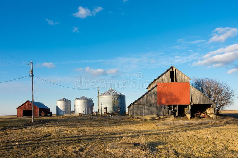 Afternoon in the Midwest. Rural farm with brilliant blue skies and clouds in background. Putnam County, Illinois, USA royalty free stock images