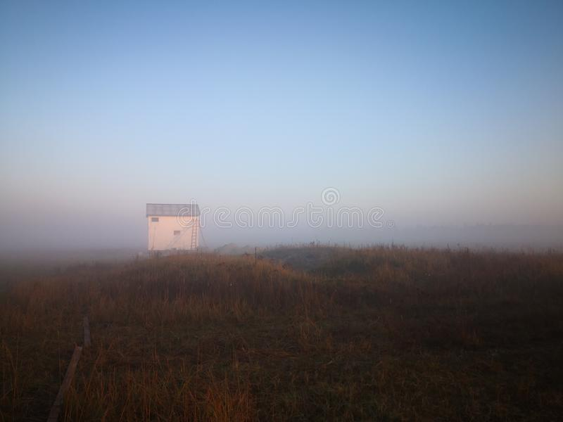 Rural farm landscape in the morning mist stock photo