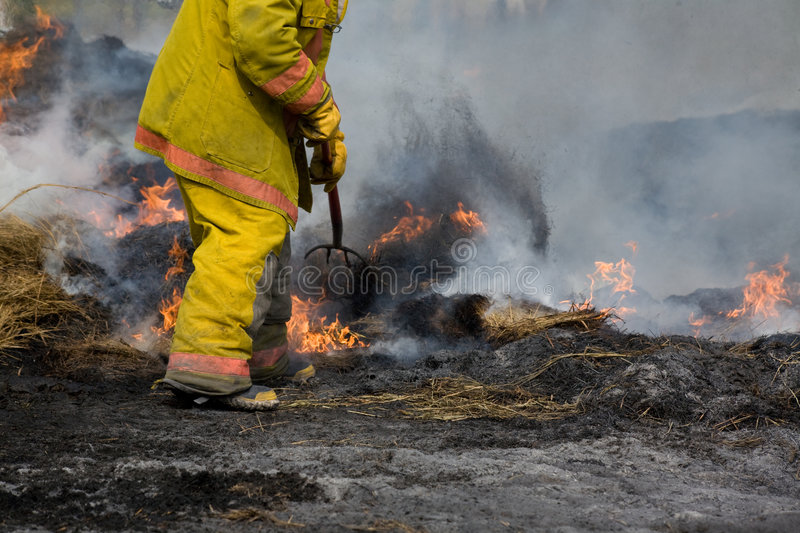 Rural fire fighter at fire royalty free stock image
