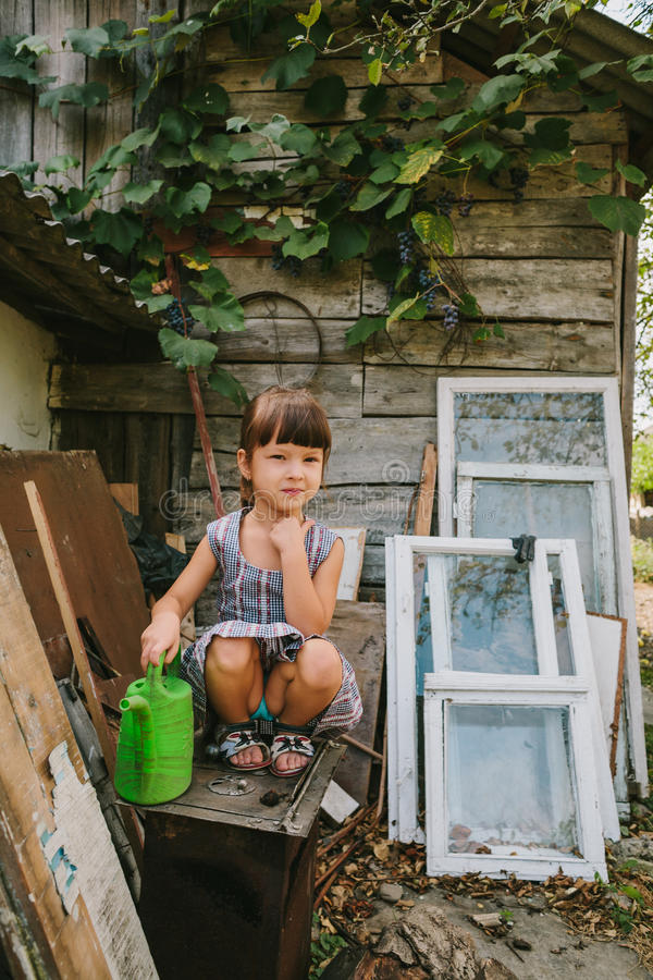 Rural girl among the old wooden trash royalty free stock photos