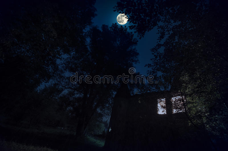 Download Rural Gothic Castle With Glowing Windows In The Dark Forest At Night Sky Moon