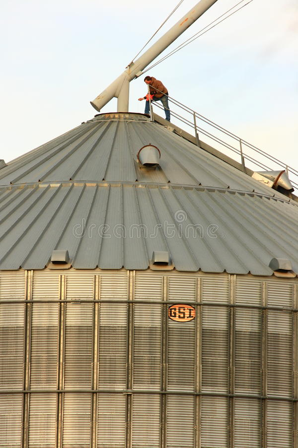 Rural Grain Worker On Top Of Metal Silo Editorial Photo