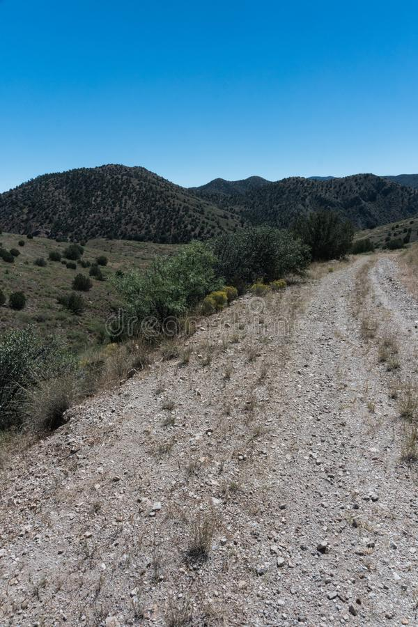 Rural Grant county New Mexico road. A back country rural dirt road in southwest New Mexico near Silver City royalty free stock photography