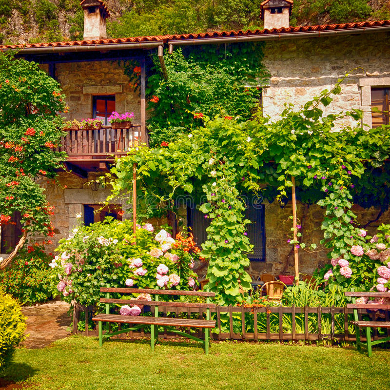 Stone Rural House With Pretty Cottage Garden. Stock Image