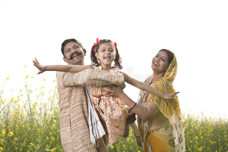 Rural Indian family having fun in agricultural field royalty free stock photography