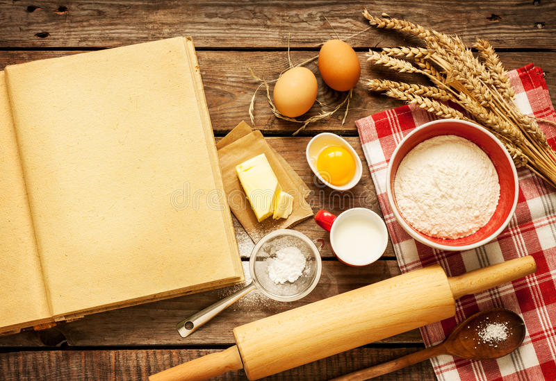 Rural kitchen baking cake ingredients and blank cook book royalty free stock image
