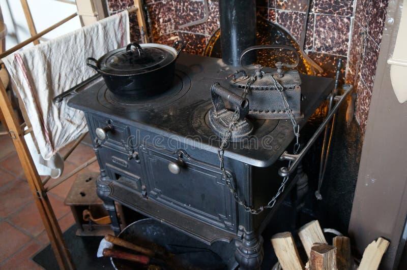 Rural kitchen tools. As wood stove, iron and pan stock photo