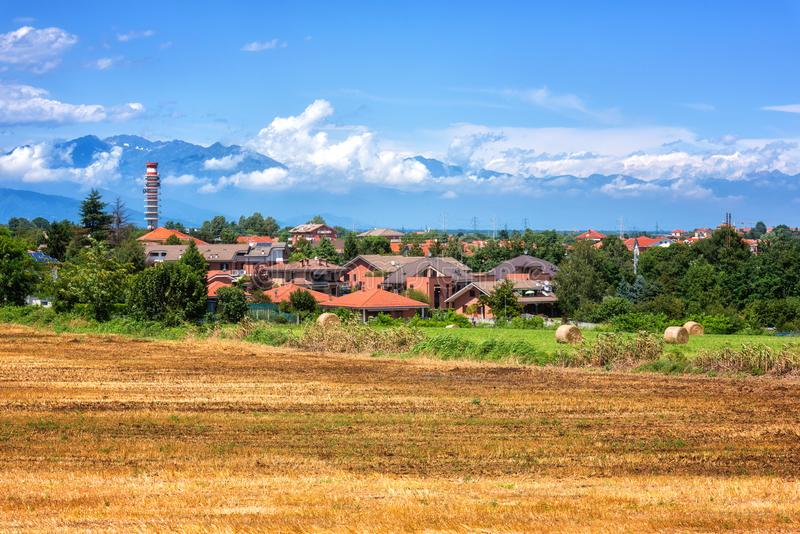 Rural landscape on a beautiful summer day, Tuscany countryside with Alps mountains and blue cloudy sky, Italy royalty free stock images