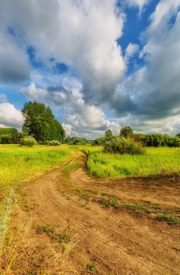 Rural landscape. Blue sky with clouds over the hills (rural landscape stock photo