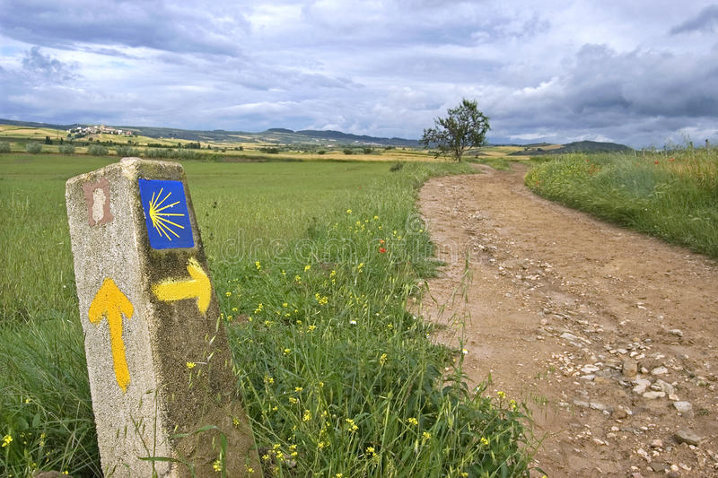 Rural landscape and direction sign Saint James Way. Spain, province, autonomous region, community, Navarra: village Los Arcos: In an agrarian landscape with corn royalty free stock photos